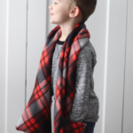 little boys with red and black pocket scarf around neck