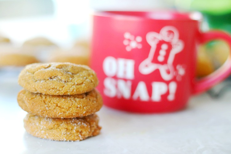 4 soft gingerbread cookies stacked by a mug of milk