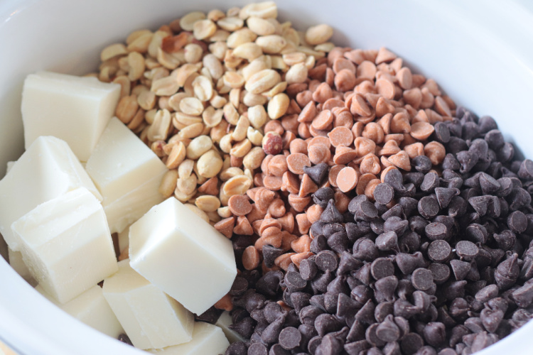 almond bark with peanuts and chocolate chips in slow cooker