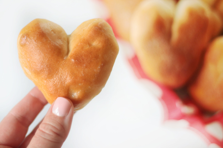 hand holding heart shaped roll