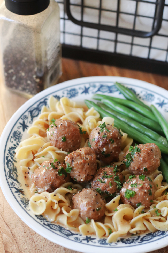 meatballs with sauce over egg noodles on plate