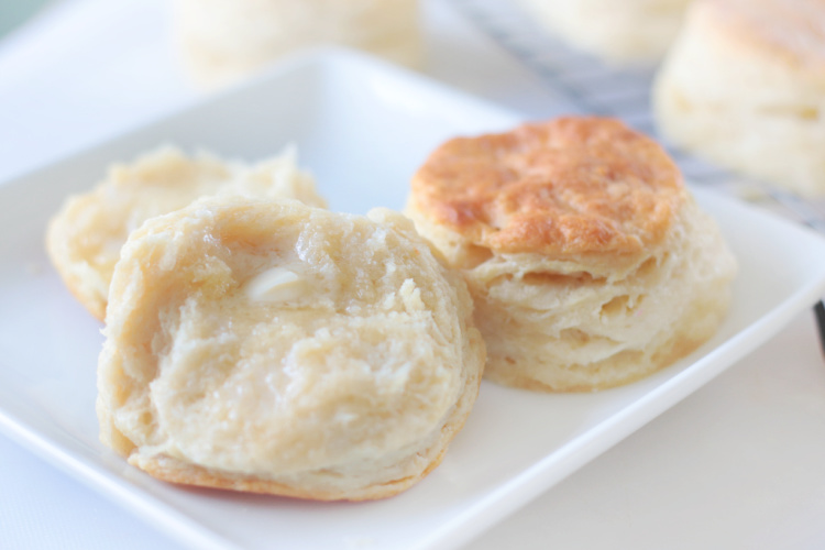 biscuit sliced in half and buttered