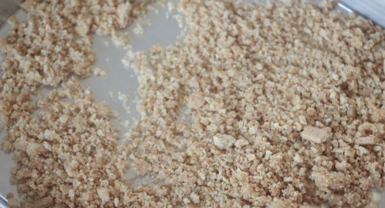 graham cracker crumbs on baking sheet