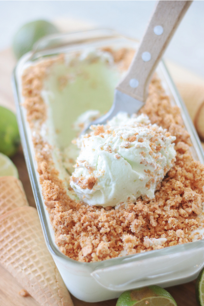 lime ice cream in loaf pan with ice cream scoop