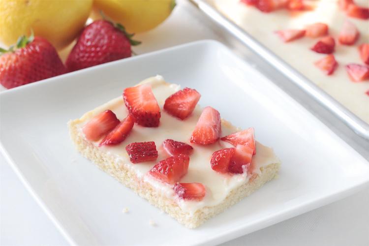 strawberry lemon sugar cookie bar on white plate