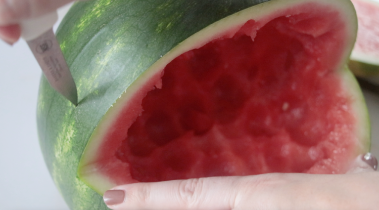 scoring watermelon with knife