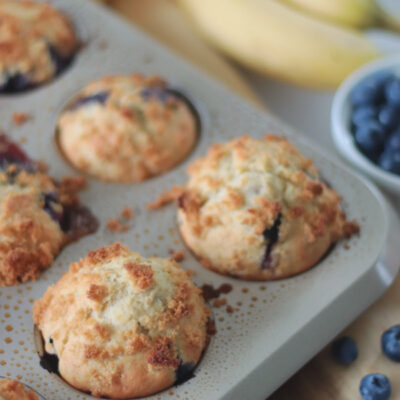 blueberry banana muffins in muffin pan