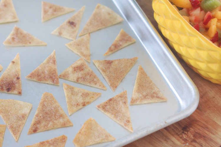 baked cinnamon tortilla chips on baking sheet