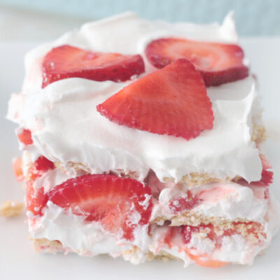 serving of strawberry ice box cake on white plate