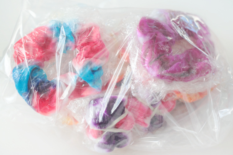 tie dyed scrunchies wrapped in plastic wrap