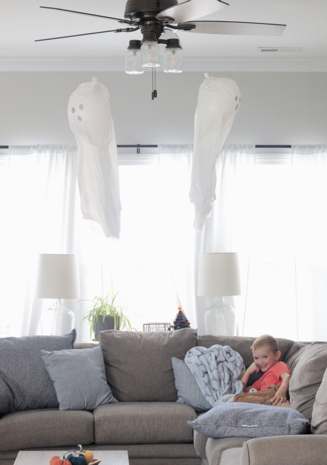 two balloon ghosts hanging from fan