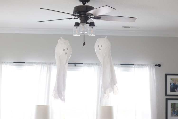 two ghosts hanging from fan