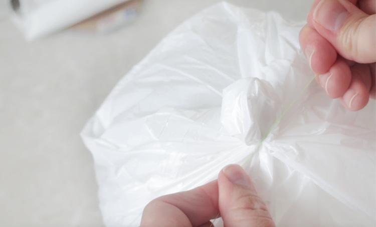 string tied around a trash bag