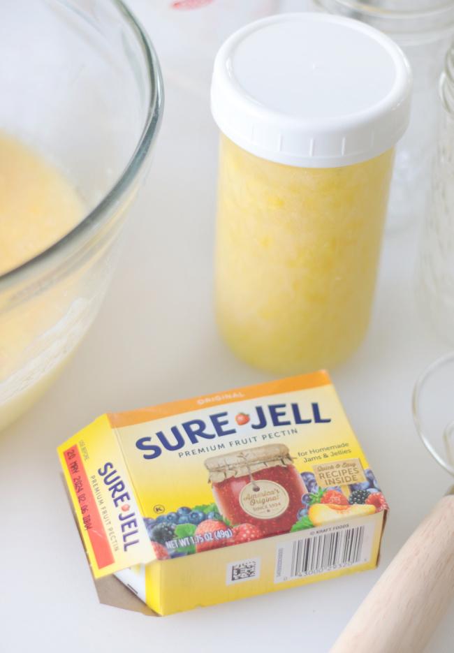 box of sure jell pectin next to jar of freezer jam
